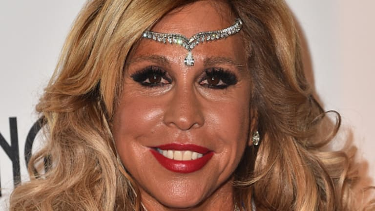 Judge Sees Lynn Tilton's Finger-, Studded Leather Jumpsuit-Prints All Over Defunct Ambulance Company