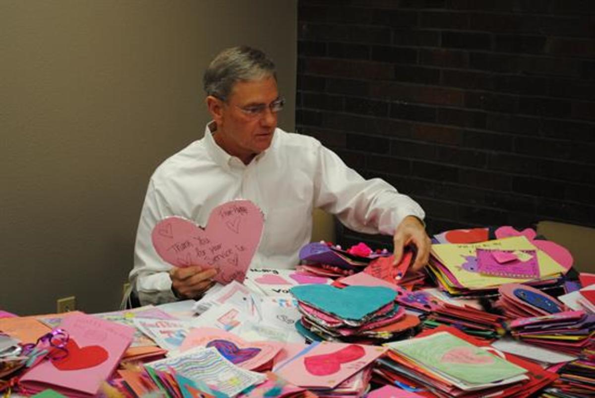 Rep. Blaine Luetkemeyer opening his early Valentine's Day cards from bank lobbyists. (Rep. Blaine Luetkemeyer)